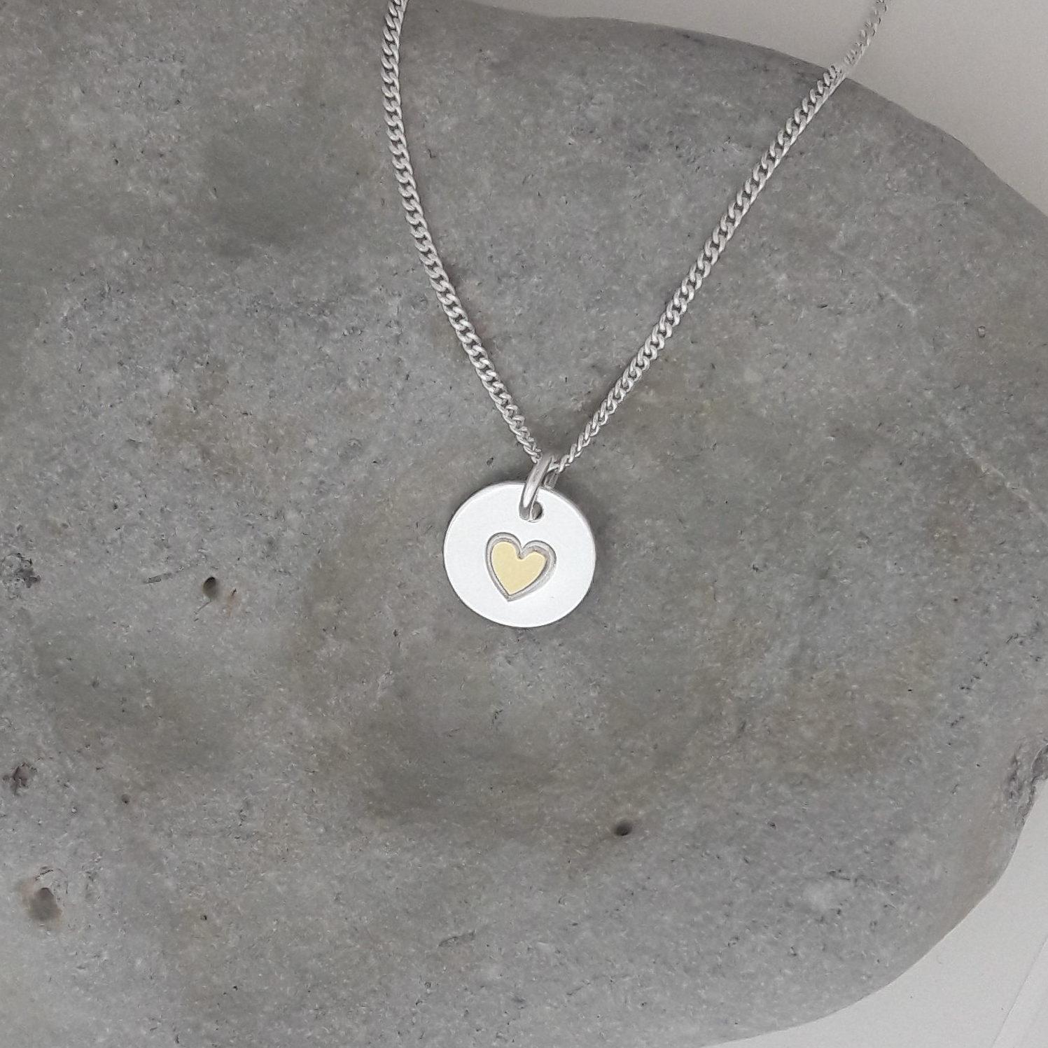 Silverberlock med guldhjärta